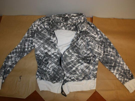 Police say a man was wearing this sweatshirt when he robbed the Lantern Lodge on Friday.