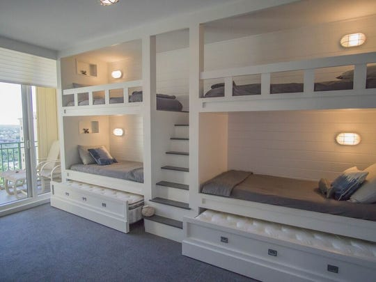 Paradise Design + Build designed this space in a Marco Island condo to sleep six children. The bunk beds are wider than most to make room for growing little ones.