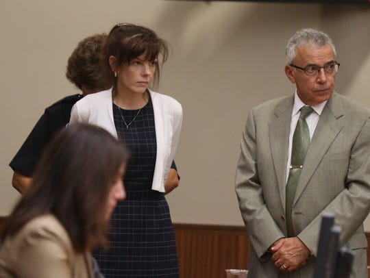 Laura Rideout is handcuffed after being found guilty.