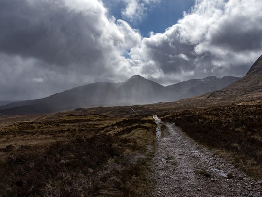 Rain with a tough muddy path ahead; with a glimpse