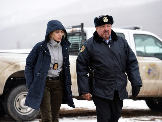 "Elizabeth Olsen and Graham Green in a scene from ""Wind River."""