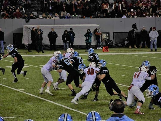 Mahwah offensive guard Michael Cantow (57) blocks a
