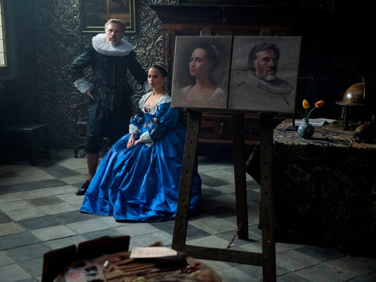 "Christoph Waltz and Alicia Vikander in a scene from ""Tulip Fever."""