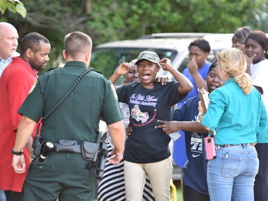 The Escambia County Sheriff's Office investigates the death of a 3-year-old at In His Arms Christian Academy on Friday, Aug. 18, 2017.