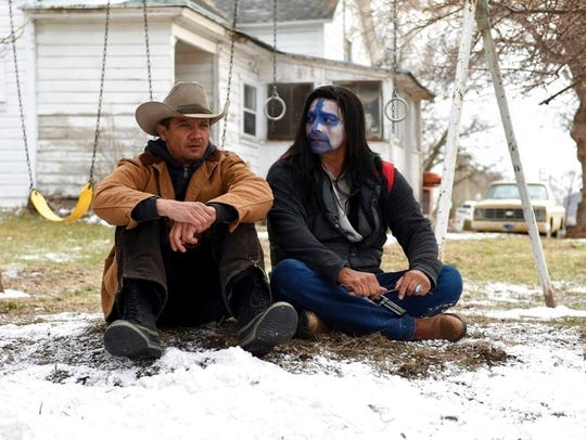 Jeremy Renner, left, and Gil Birmingham in a scene
