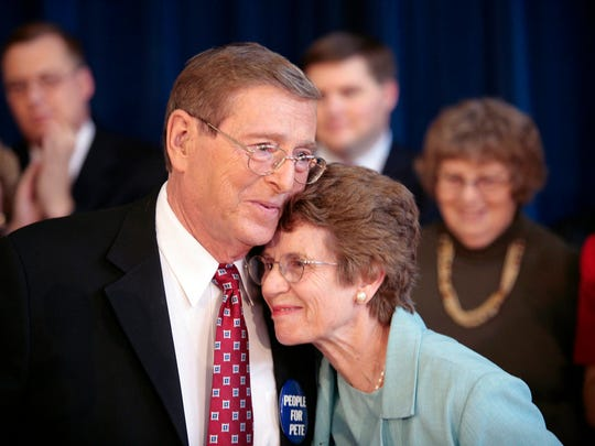 FILE - In this Thursday, Oct. 4, 2007, file photo, Sen. Pete Domenici, R-N.M., embraces his wife Nancy, right, as he finishes a news conference, in Albuquerque, N.M.