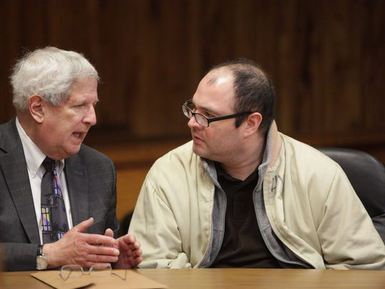 Francisco Pacheco, right, consults with attorney Miles