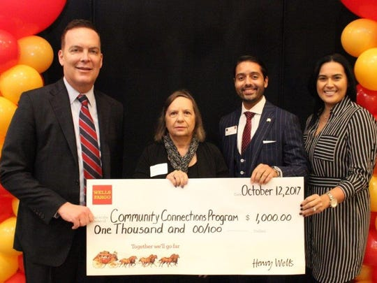 The Woman's Club of Parsippany-Troy Hills was awarded a $1,000 grant in Oct. by Wells Fargo Foundation to support WCPTH'S mission of volunteerism and service to their community, and beyond.   Pictured (from left to right) are: Wells Fargo Northern New Jersey's Region Bank President Greg White;  WCPTH club member Lois Preis White; Branch Manager Angel Moreno; Mid Morris District Manager Ana Matos.