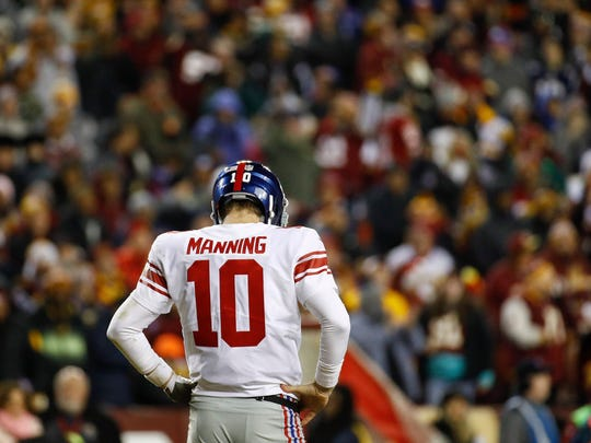 New York Giants quarterback Eli Manning (10) looks down at the turf during the second half of an NFL football game against the Washington Redskins in Landover, Md., Thursday, Nov. 23, 2017.