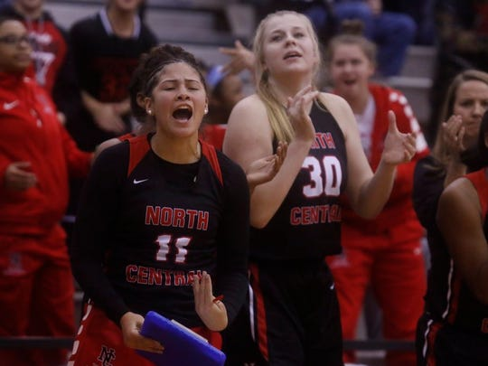 Injured North Central standout Taylor Ramey (11) cheers on the Panthers during Saturday's Marion County title win.