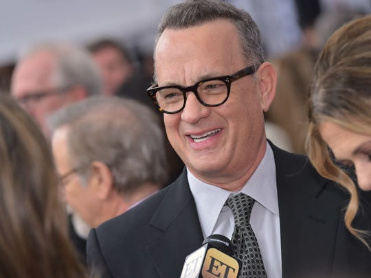 "Actor Ton Hanks arrives for the premiere of ""The Post"" on December 14, 2017, in Washington, DC. / AFP PHOTO / Mandel NGAN        (Photo credit should read MANDEL NGAN/AFP/Getty Images)"