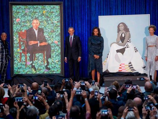TOPSHOT-US-POLITICS-ART-HERITAGE-OBAMA