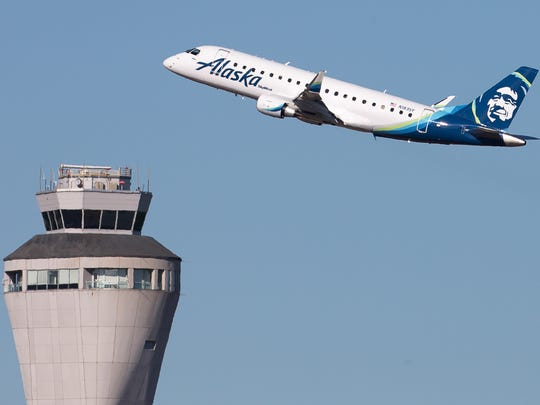 An Alaska Airlines Embraer E170/75 takes off from SeaTac International Airport in July 2017.