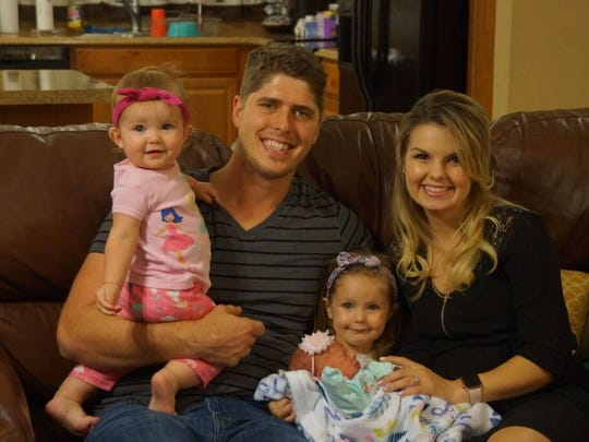 From left, Lexi Mae, John, Zoey Joy, Allie Jane and Alyssa Webster pose for a photo after Zoey Joy was born March 28.