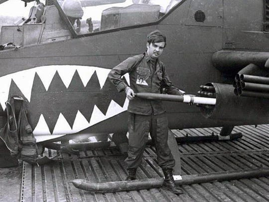 Bob Hesselbein of Middleton loads rockets on his Cobra helicopter in Vietnam in 1972. Hesselbein and other Vietnam helicopter crew members were instrumental in getting a memorial at Arlington National Cemetery that will be dedicated on April 18.