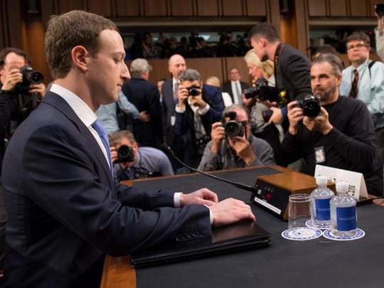 Facebook founder and CEO Mark Zuckerberg prepares to testify during a Senate Commerce, Science and Transportation Committee and Senate Judiciary Committee joint hearing about Facebook on Capitol Hill.