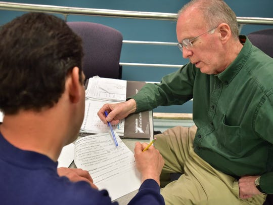Dave Fogarty of Rutherford, a volunteer teacher at Project Literacy, works with a student identified only as James at Bergen Community College.