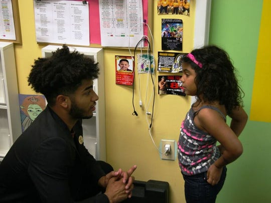 Carlos Polanco talking with a young member of the Boys & Girls Club of Clifton.