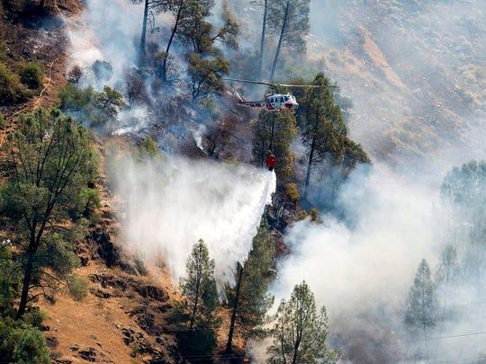 Crews battle the Ferguson Fire along steep terrain