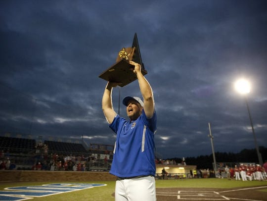 Brookfield Central head coach Jeff Bigler holds up