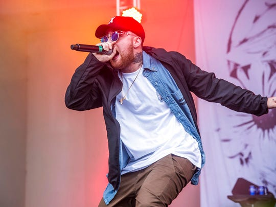 In this July 29, 2016 file photo, Mac Miller performs at Lollapalooza in Chicago. Miller, the platinum hip-hop star whose rhymes vacillated from party raps to lyrics about depression and drug use, died Sept. 7, 2018 at 26.