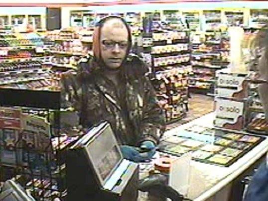 636553459032639725-gpg-0227robbery-suspect.jpg