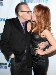 "Kathy Griffin and Larry King have a close encounter at SiriusXM's ""Howard Stern Birthday Bash"" in 2014 in New York City."