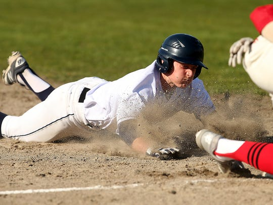 Brooks Lierle of Bainbridge slides safely into third during an 8-2 loss to Ballard on Wednesday at Bainbridge High.