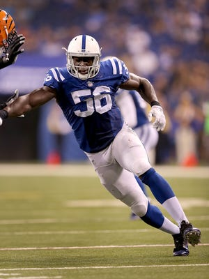 Indianapolis Colts linebacker Daniel Adongo (56) rushes on Cincinnati Bengals tackle Matthew O'Donnell (79) in the second half of their preseason game Thursday, September 3, 2015, at Lucas Oil Stadium.