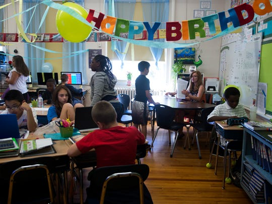 Teacher Kathryn Branam's fourth-grade class works on