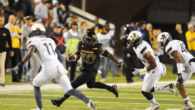 University of Southern Mississippi's running back Jalen Richard (30) sprints past the Old Dominion defense on Saturday at M.M. Roberts Stadium.