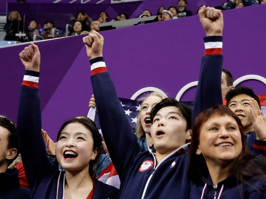 Maia Shibutani, left, and Alex Shibutani react as their score is posted at the 2018 Winter Olympics.