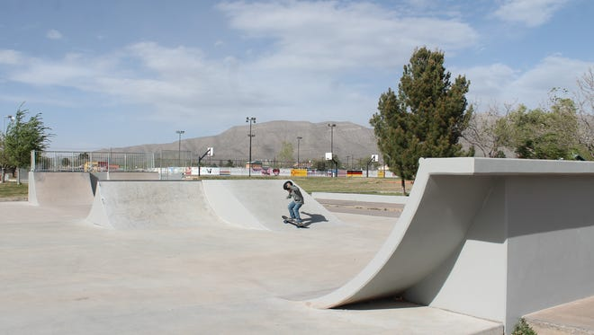A young Alamogordo resident works on his skateboarding on Wednesday afternoon in the newly repainted skate park.