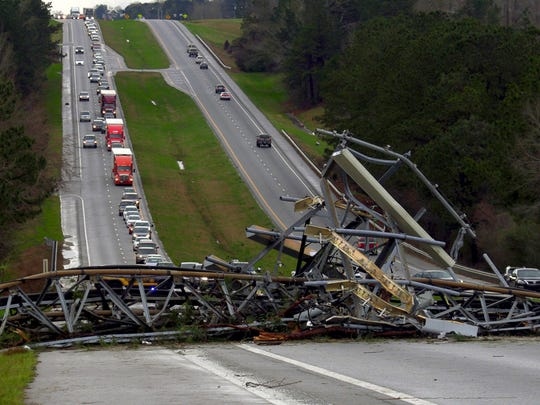 A fallen cell tower lies across U.S. Route 280 highway in Lee County, Ala., in the Smiths Station community after what appeared to be a tornado struck in the area Sunday.