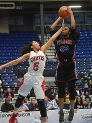 Tiara Young (23, formerly of Evangel) shoots over John