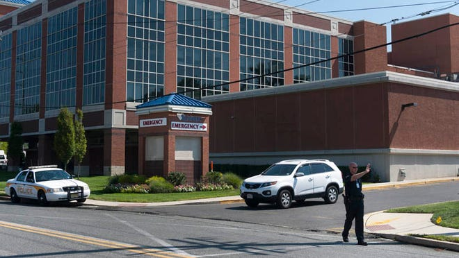 Police block the entrance to Kennedy University Hospital in Stratford after a husband shot and killed his wife, then shot himself, inside a hospital room Wednesday morning, August 27, 2014.