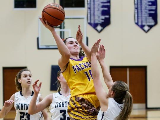 Cudahy senior Hannah Kulas (10) takes flight for a shot during the game at Lake Country Lutheran on Saturday, Jan. 13.