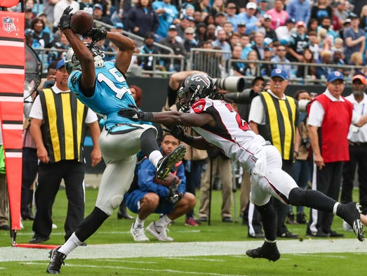 Carolina Panthers wide receiver Russell Shepard tries