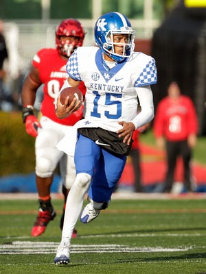 Stephen Johnson of Kentucky runs with the ball during the game against the Louisville Cardinals at Papa John's Cardinal Stadium on November 26, 2016 in Louisville, Kentucky.
