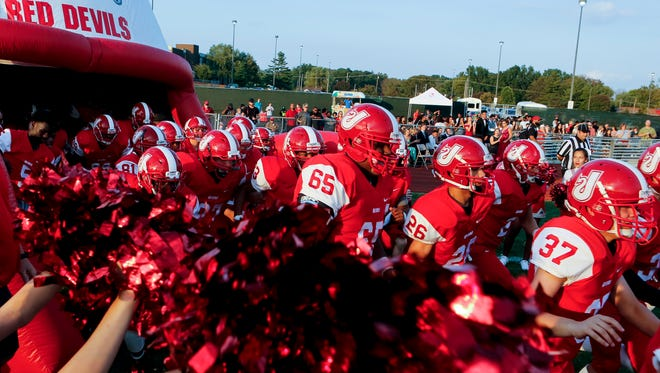 Jeffersonville enters the field through the giant helmet.