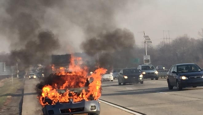 Vehicle fire closes right lane of southbound I-495 near 12th Street Thursday morning.
