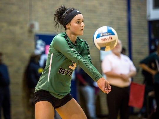 Brown City senior Becki Krause digs the ball during a Class C regional volleyball game Thursday, Nov. 10, 2016 at Flint Hamady High School.