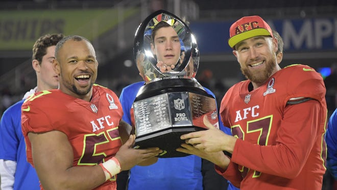 Lorenzo Alexander, left, was named defensive MVP and Travis Kelce was offensive MVP for the AFC.