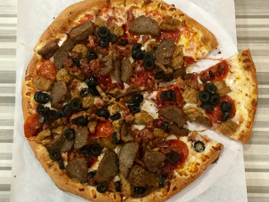 The meat lover's pie at the new Piezzetta Pizza Kitchen in Circus Circus Reno is loaded with meatballs, pepperoni, sausage and bacon.