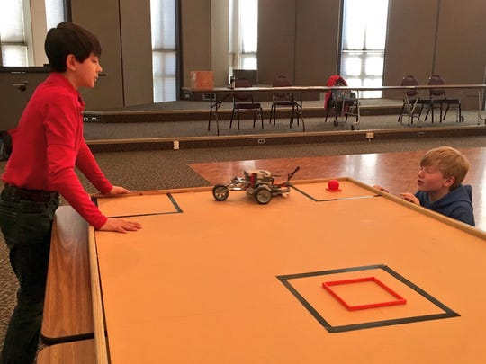 Blaise Ramirez (left) and Carson Wall, students at Donnie Bickham Middle School in Shreveport, test their robot for an accuracy challenge Wednesday at Northwestern State University's first robotics competition for middle-schoolers.