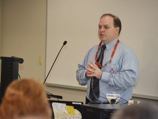 Robert Bready, chief investigator at the Dutchess County Medical Examiner's Office, leads a presentation on what it means to be a medical examiner at the Dutchess County Department of Community & Behavioral Health building in the City of Poughkeepsie.