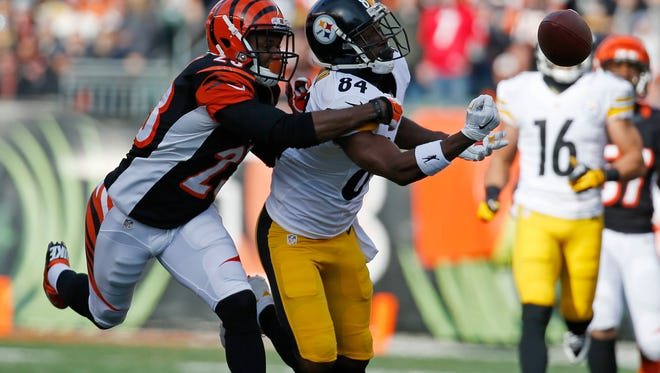 Bengals cornerback Terence Newman breaks up a pass to Steelers wide receiver Antonio Brown on Dec. 7.