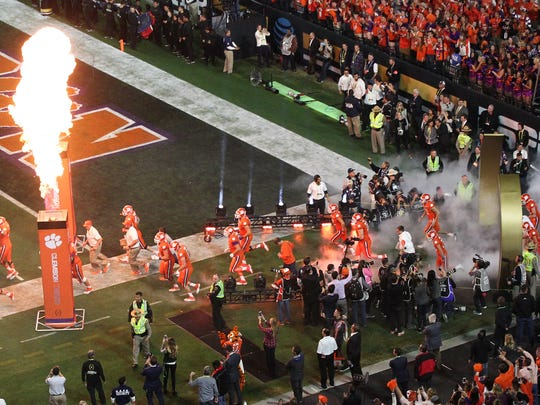 Clemson players take the field before kickoff at University of Phoenix Stadium.