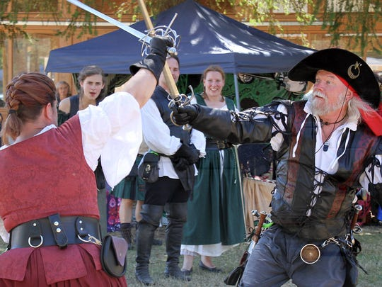 Amanda Shadwell and Dameon Willich, members of the Seattle Knights combat troupe, conduct a sword fight at the Hood Canal Highland Celtic Festival held this weekend in Belfair.