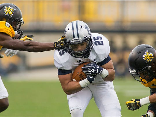 Monmouth's Pete Guerriero splits the Kennesaw State defenders during the Big South Conference game on  Saturday Nov. 18, 2017.